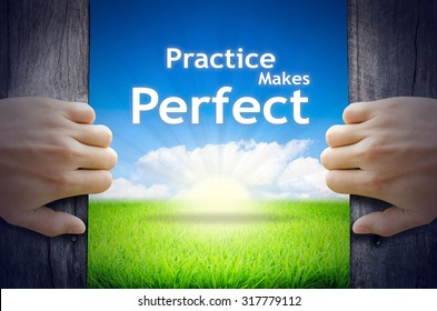 """Motivational quotes """"Practice makes Perfect"""". Hands opening a wooden door then found a texts floating among new world as green grass field, Blue sky and the Sunrise."""