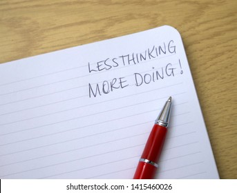 Motivational writing / quote on a lined paper notepad with a red pen on the white paper.  Writing and pen to motivate in life or business, for sales motivation or other purpose.