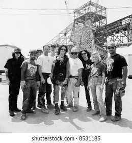 Motley Crue: Rockers John Corabi, Nikki Sixx, Tommy Lee, and Mick Mars with construction workers at The Rock and Roll Hall of Fame in 1994.