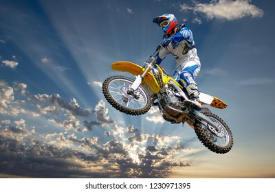 A moto cross rider against a dramatic sunset, South Africa.