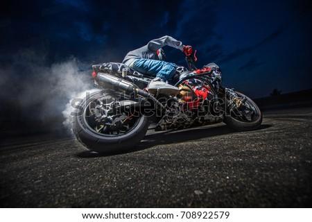 Moto rider making a