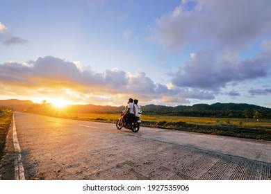 Motobike on the road at sunset time.
