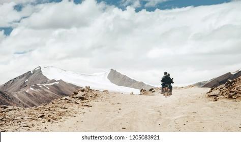 Motobike travelers ride on mountain pass road in indian Himalaya