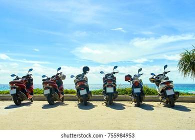 Motobikes on he beach. Blue sky, sea.
