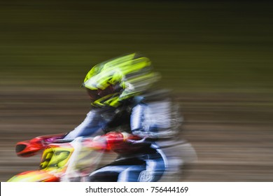 Motocross dirt bike ride speeding during a competition.