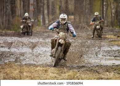 Motocross driver on wet and muddy terrain in Finland.