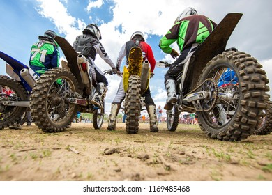 Motocross. Motorcycles getting ready for the start of the rear view