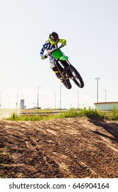 Motocross rider in action accelerating the motorbike  on the race track.