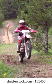 a motocross rider on a mountain trail