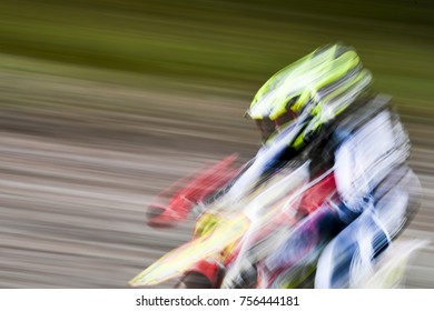 Motocross rider speeding along during a competition.