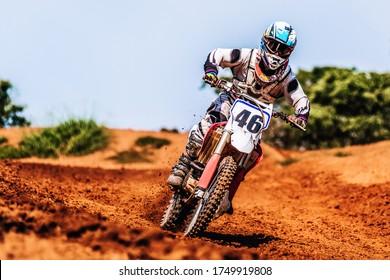 Motocross Rider Speeding Downhill in Mud Track