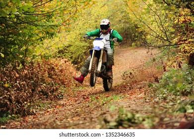 Motocross rider wheelie