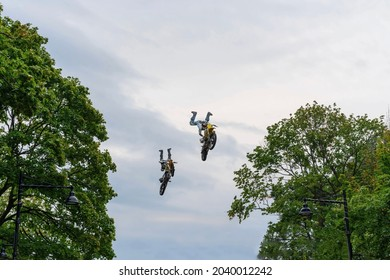 Motocross riders fly high to perform airborne stunts