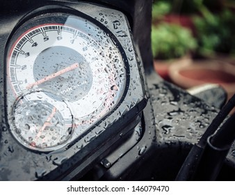 motor bike  fuel meter tachometer and ignition with dew droplets