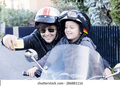 motor bikers father and son take a selfie on the road