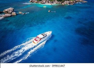 Motor boat in amazing colorful water of Seychelles Coco Island nature
