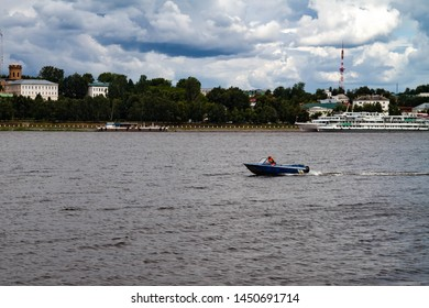 Motor boat floating on the Volga river in Kostroma. Panorama of the city of Kostroma.