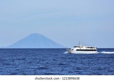 motor boat in front of Stromboli volcano