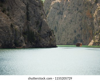 Motor boat in the green canyon, Turkey