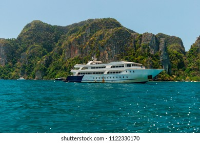 Motor boat and island in the sea