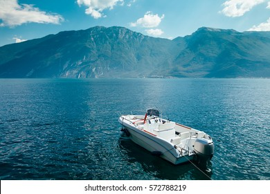Motor boat on beautiful Garda lake, Italy. Vacation background