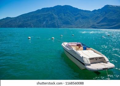 Motor boat on Lake Garda in Limone sul Garda, Lombardy, Italy