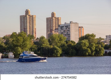 Motor boat on the river in the city