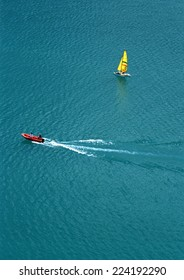 Motor boat and sail boat at sea, aerial view