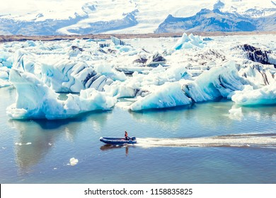 motor boat sailing on the azure waters between the jokulsarlon blue lagoon icebergs