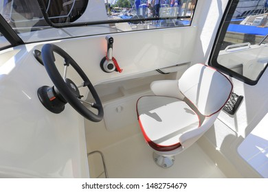 Motor boat steering wheel with throttle control in cockpit
