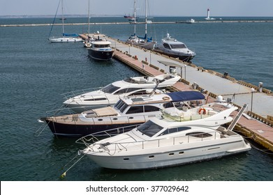 Motor boats at the pier on the sea