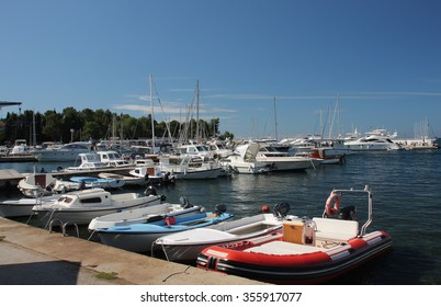 Motor boats and sailboats in harbor in Porec,Croatia  on a summer day
