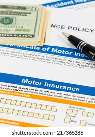 Motor or car insurance application with pen, and dollar banknote