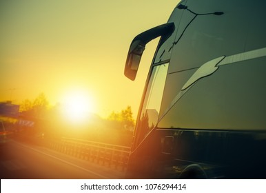Motor Coach Bus on the Route During Scenic Sunset. Bus Transportation.