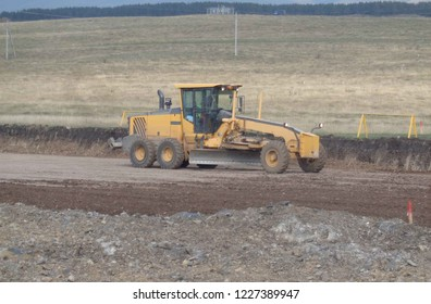Motor grader leveling works during a highway / road construction project