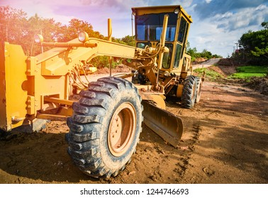 Motor grader tractor working at road construction site