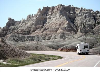 Motor home RV driving into the Badlands of South Dakota.