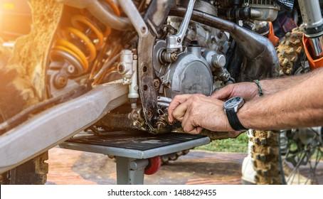 motor mechanic working on car engine in mechanics garage. Repair service. authentic close-up shot