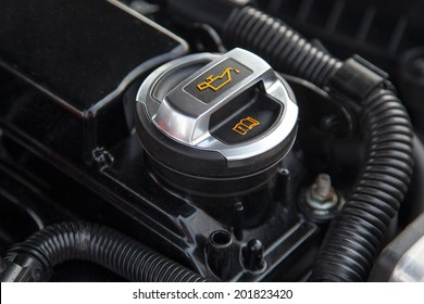 Motor oil cap under the hood of a car
