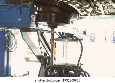 motor oil container for filling old engine oil from car in automobile repair service garage