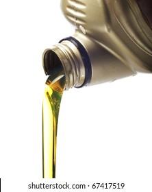 Motor oil poring over white background