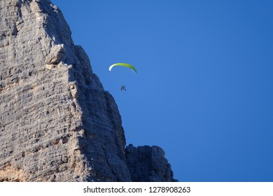 Motor paraglider close to the rock of the three peaks of Tre Cime di Lavaredo in South Tyrol Italy