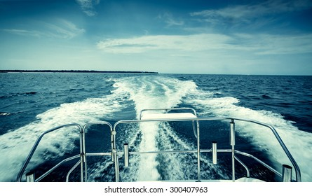 Motor power boat speeding on the Atlantic Ocean. Vacation, summer, travel, water sports,  lifestyle concept, boat rental and sales concept.