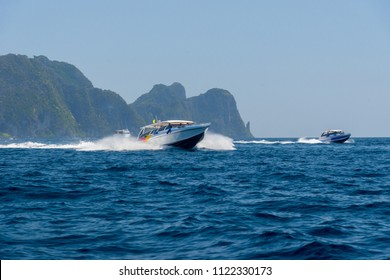 Motor speed boat and island in the sea