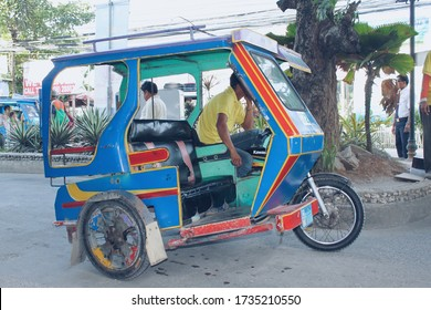 Motor tricycle are the both cheap common means transportation and symbol of Philippine culture.