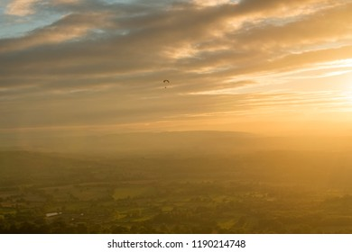 Motor trike hang glider flying in the sunset Malvern hills Worcestershire