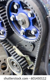 Motor and two pulleys CAMSHAFT TIMING. With belt transmission of rotation