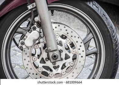 a motor wheel tire on the sidewalk