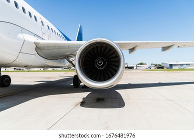 Motor and a wing of an aircraft plane at the airport. Airline, aeronautics, and travelling concept.