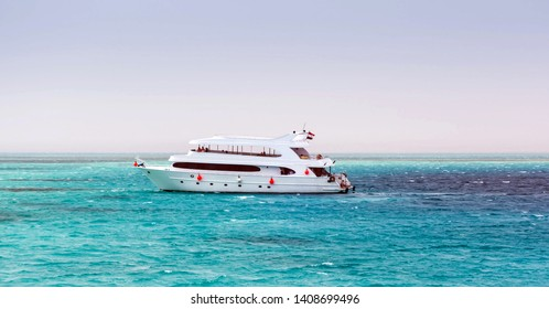 Motor Yacht seascape white sandy island Egypt Maldives Atoll. Landscape of the Red Sea Dahab in Egypt.